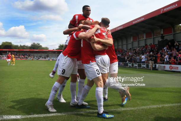 Salford players including Ibou Touray celebrate their opening goal during the Vanarama National League match between Salford City and Leyton Orient...