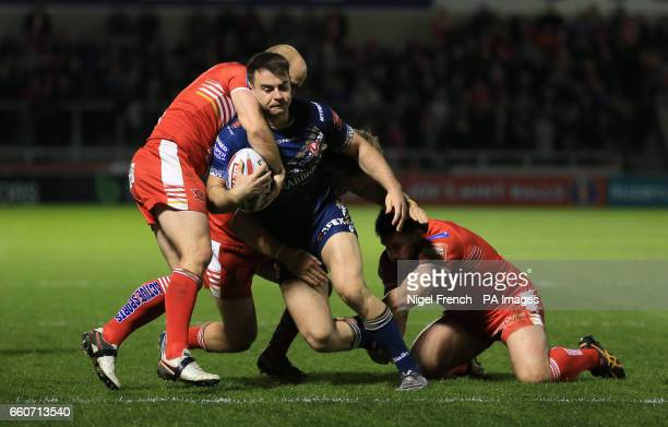 Salford Red Devils 'Michael Dobson and Justin Carney tackle St Helens' Ryan Morgan during the Betfred Super League match at the AJ Bell Stadium...