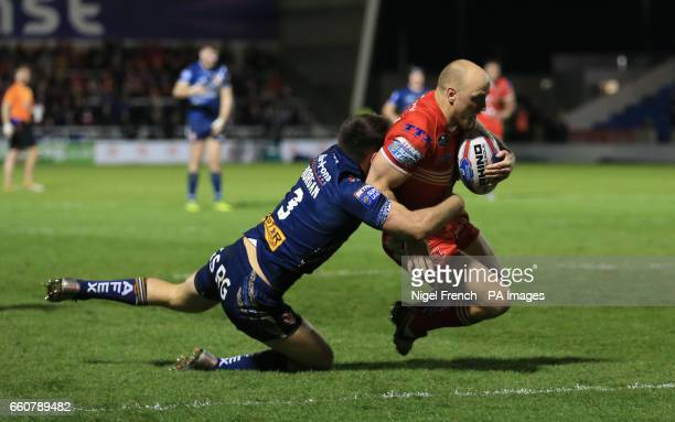 Salford Red Devils' Michael Dobson scores his sides third try of the game against St Helens during the Betfred Super League match at the AJ Bell...