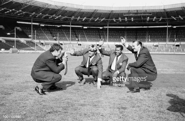 Salford Red Devils rugby league team members inspect the pitch at Wembley Stadium ahead of their Challenge Cup Final match against Castleford...