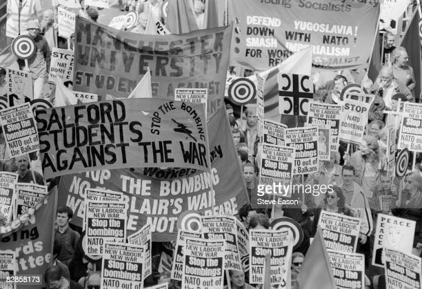 Salford students and people carrying Socialist Worker placards protest in London against the NATO bombing of Yugoslavia during the Kosovo War 5th...
