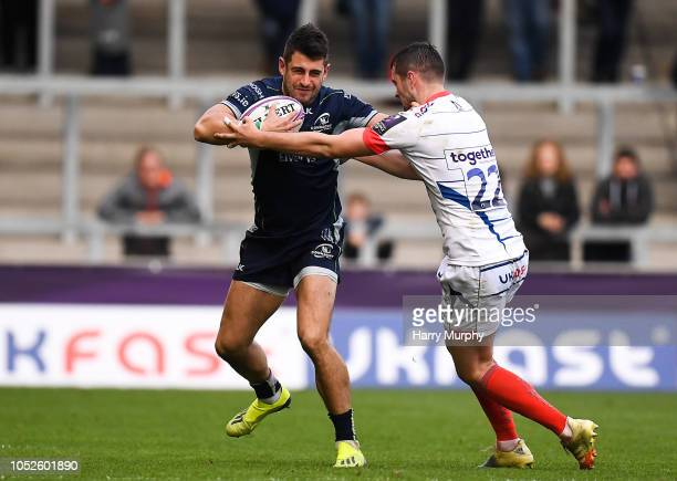 Salford United Kingdom 20 October 2018 Tiernan O'Halloran of Connacht is tackled by Luke James of Sale Sharks during the Heineken Challenge Cup Pool...