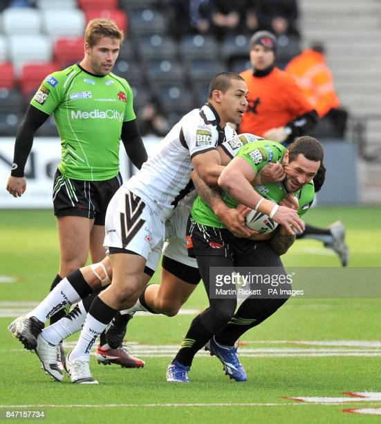 Salford's Vinnie Anderson is tackled by Widnes' Frank Winterstein and Willie Isa during the Stobart Super League match at the Stobart Stadium Halton...