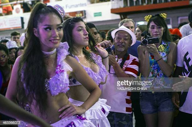 Salgueiro samba school's Japanese female passista Megumi Kudo is recorded by her mother Taeko and her father Takashi from Japan during a show at the...