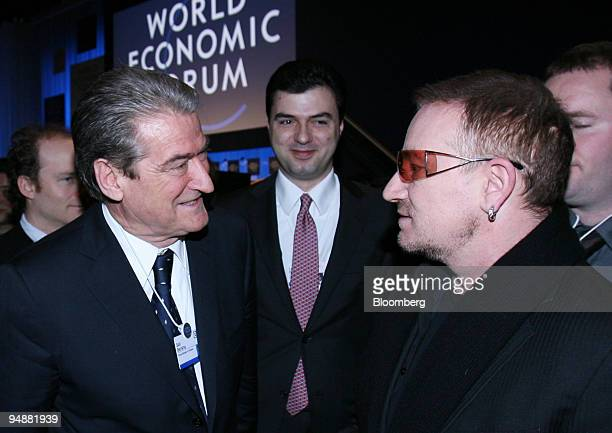 Sali Berisha Albania's prime minister left speaks with Bono lead singer of Irish rock group U2 and cofounder of Debt AIDS Trade Africa on day four of...