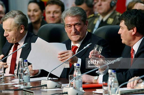 Sali Berisha Albania's prime minister smiles following a speech during the NATO summit in Bucharest Romania on Thursday April 3 2008 NATO rebuffed...