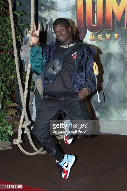 Salif Gueye attends the photocall of the Jumanji Next Level film at le Grand Rex on December 03 2019 in Paris France
