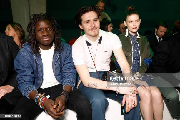 Salif Lasource Brooklyn Beckham and Kate Mara attend the Lacoste show as part of the Paris Fashion Week Womenswear Fall/Winter 2019/2020 on March 05...
