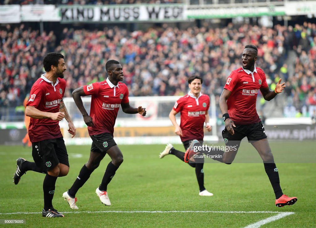 Salif SanŽ of Hannover celebrates scoring his goal during the Bundesliga match between Hannover 96 and FC Augsburg at HDI-Arena on March 10, 2018 in Hanover, Germany.