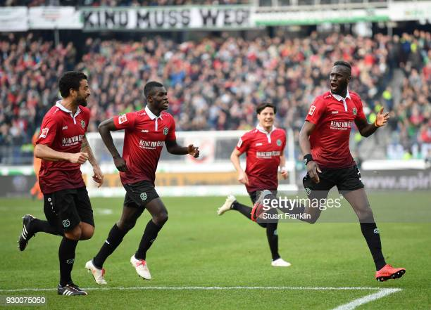 Salif SanŽ of Hannover celebrates scoring his goal during the Bundesliga match between Hannover 96 and FC Augsburg at HDIArena on March 10 2018 in...