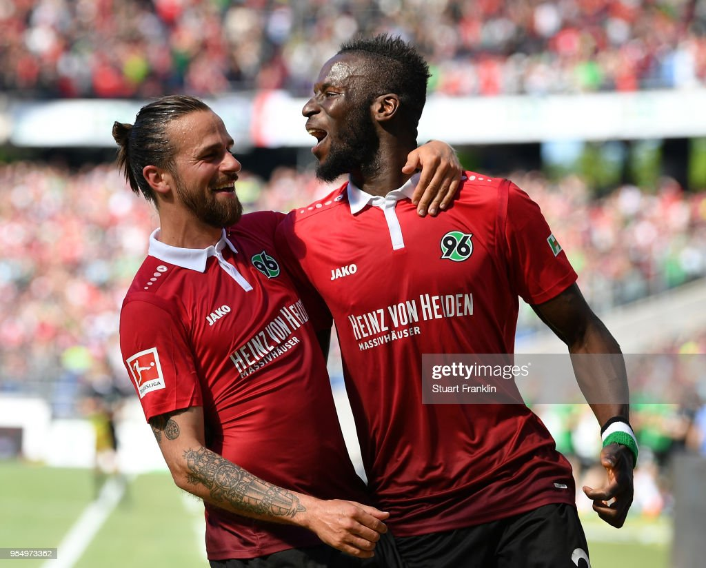 Salif SanŽ of Hannover celebrates scoring the second goal with Martin Harnik during the Bundesliga match between Hannover 96 and Hertha BSC at HDI-Arena on May 5, 2018 in Hanover, Germany.