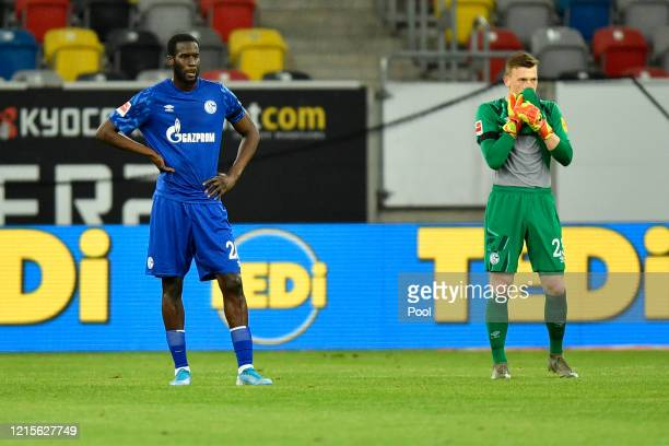 Salif Sane and Markus Schubert of FC Schalke 04 react to their side conceding there second goal during the Bundesliga match between Fortuna...