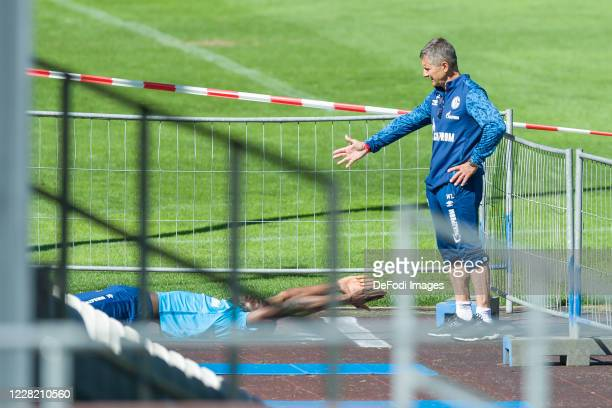Salif Sane of FC Schalke 04 and Atheltic coach Werner Leuthard of FC Schalke 04 looks on during the FC Schalke 04 Training Camp on August 25, 2020 in...