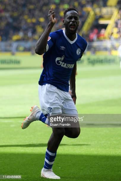 Salif Sane of FC Schalke 04 celebrates as he scores his team's second goal during the Bundesliga match between Borussia Dortmund and FC Schalke 04 at...