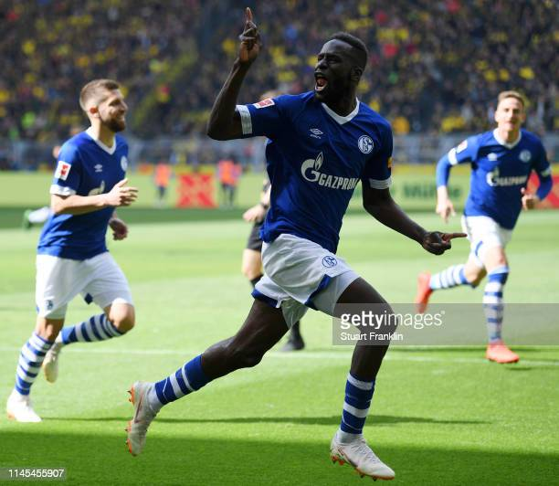Salif Sane of FC Schalke 04 celebrates as he scores his team's second goal during the Bundesliga match between Borussia Dortmund and FC Schalke 04 at...
