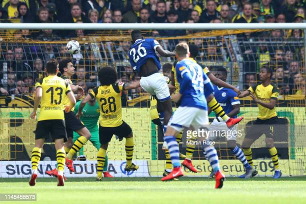 Salif Sane of FC Schalke 04 scores his team's second goal during the Bundesliga match between Borussia Dortmund and FC Schalke 04 at Signal Iduna...