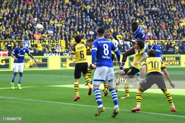 Salif Sane of FC Schalke 04 scores his team's second goal during the Bundesliga match between Borussia Dortmund and FC Schalke 04 at Signal Iduna...