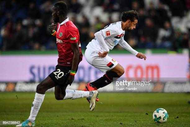 Salif Sane of Hannover 96 and Karim Bellarabi of Bayer Leverkusen battle for the ball during the Bundesliga match between Hannover 96 and Bayer 04...