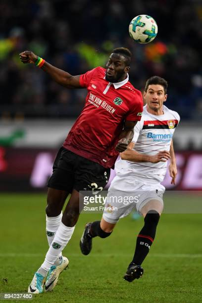Salif Sane of Hannover 96 and Lucas Alario of Bayer Leverkusen battle for the ball during the Bundesliga match between Hannover 96 and Bayer 04...