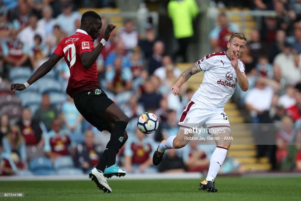 Salif Sane of Hannover 96 and Scott Arfield of Burnley during the Pre-Season Friendly between Burnley and Hannover 96 at Turf Moor on August 5, 2017 in Burnley, England.