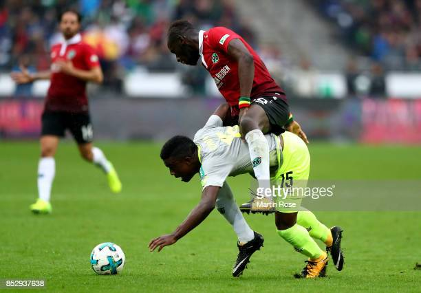 Salif Sane of Hannover and Copete Cordoba of Koeln battle for the ball during the Bundesliga match between Hannover 96 and 1 FC Koeln at HDIArena on...