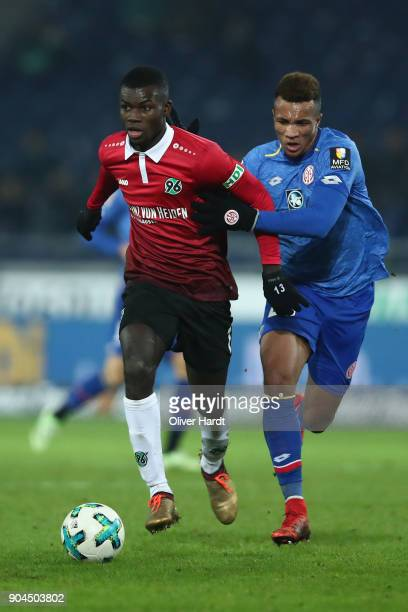 Salif Sane of Hannover and Jean Philippe Gbamin of Mainz compete for the ball during the Bundesliga match between Hannover 96 and 1 FSV Mainz 05 at...