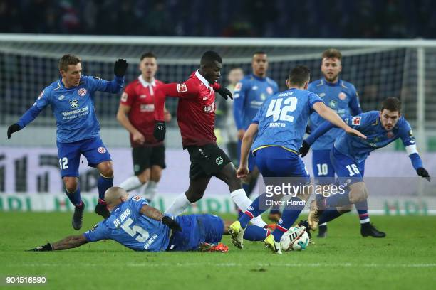 Salif Sane of Hannover and Nigel de Jong of Mainz compete for the ball during the Bundesliga match between Hannover 96 and 1 FSV Mainz 05 at HDIArena...