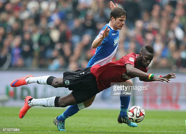 Salif Sane of Hannover and Pirmin Schwegler of Hoffenheim compete for the ball during the Bundesliga match between Hannover 96 and 1899 Hoffenheim at...