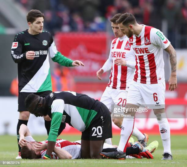 Salif Sane of Hannover looks after Simon Terodde of Koeln during the Bundesliga match between 1 FC Koeln and Hannover 96 at RheinEnergieStadion on...