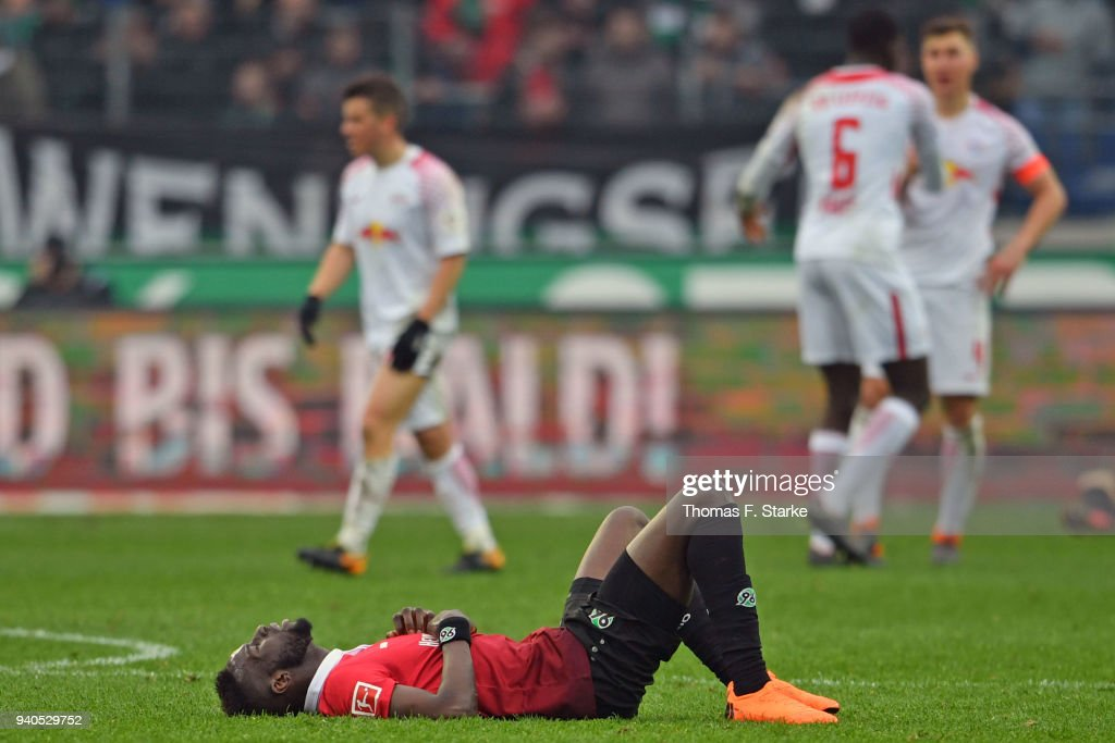 Salif Sane (FRONT) of Hannover looks dejected after the Bundesliga match between Hannover 96 and RB Leipzig at HDI-Arena on March 31, 2018 in Hanover, Germany.