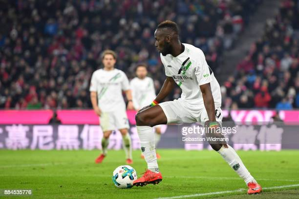 Salif Sane of Hannover plays the ball during the Bundesliga match between FC Bayern Muenchen and Hannover 96 at Allianz Arena on December 2 2017 in...