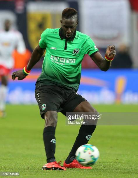 Salif Sane of Hannover runs with the ball during the Bundesliga match between RB Leipzig and Hannover 96 at Red Bull Arena on November 4 2017 in...