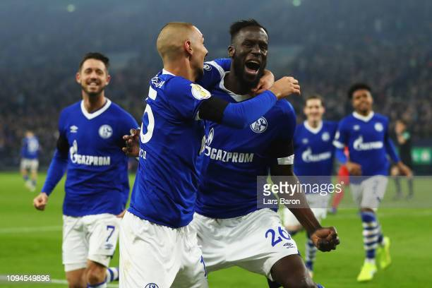 Salif Sane of Schalke 04 celebrates scoring his teams second goal of the game with team mates during the DFB Pokal Cup match between FC Schalke 04...