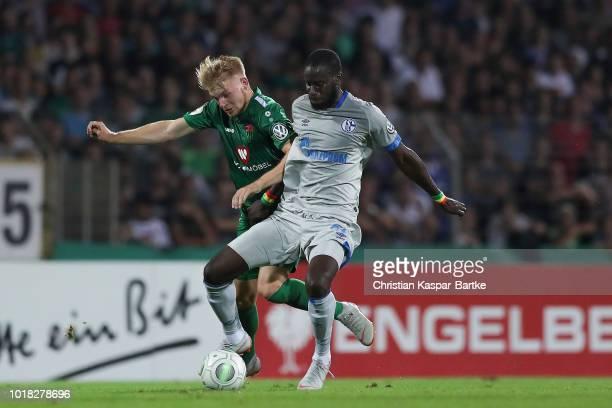 Salif Sane of Schalke 04 challenges Stefan Maderer of Schweinfurt during the first round match of DFB Cup between 1 FC Schweinfurt 05 and FC Schalke...