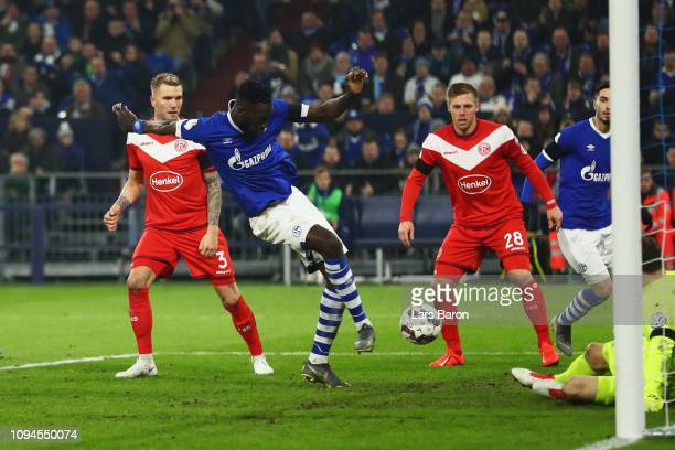 Salif Sane of Schalke 04 shoots and scores his teams second goal of the game during the DFB Pokal Cup match between FC Schalke 04 and Fortuna...