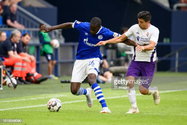 Salif Sane of Schalke and Giovanni Simeone of Fiorentina battle for the ball during the friendly match between FC Schalke 04 and AFC Fiorentina at...