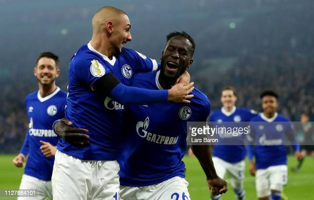 Salif Sane of Schalke celebrates after scoring his teams second goal during the DFB Pokal Cup match between FC Schalke 04 and Fortuna Duesseldorf at...