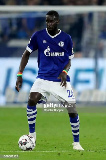 Salif Sane of Schalke runs with the ball during the Bundesliga match between FC Schalke 04 and FC Bayern Muenchen at VeltinsArena on September 22...