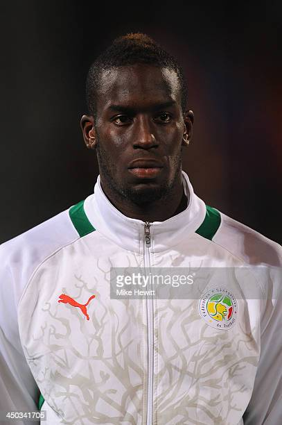 Salif Sane of Senegal lines up for the National Anthem during the FIFA 2014 World Cup Qualifier Playoff Second Leg between Senegal and Ivory Coast at...