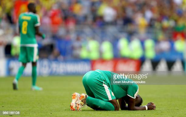 Salif Sane of Senegal looks dejected following his sides defeat in the 2018 FIFA World Cup Russia group H match between Senegal and Colombia at...