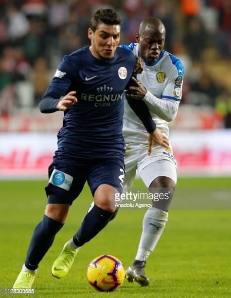 Salih Dursun of Antalyaspor in action against Dever Orgill of MKE Ankaragucu during Turkish Super Lig soccer match between Antalyaspor and MKE...