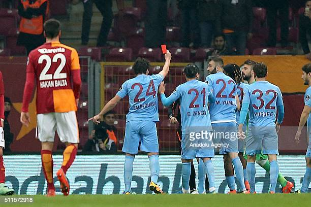 Salih Dursun of Trabzonspor shows a red card to referee as he takes the card from referee's hand to react his decisions during Turkish Spor Toto...