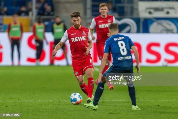 Salih Oezcan of 1.FC Koeln and Dennis Geiger of TSG 1899 Hoffenheim battle for the ball during the Bundesliga match between TSG Hoffenheim and 1. FC...
