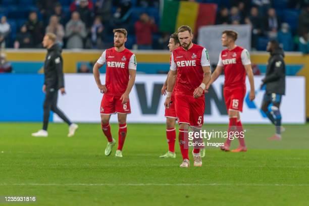 Salih Oezcan of 1.FC Koeln, Rafael Czichos of 1.FC Koeln and Luca Kilian of 1.FC Koeln looks dejected after the Bundesliga match between TSG...