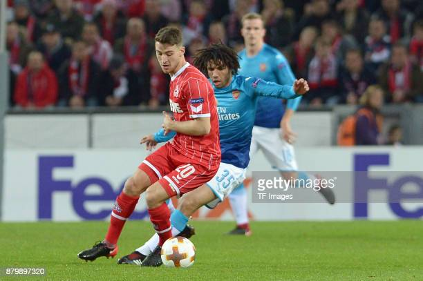 Salih Oezcan of Cologne and Mohamed Elneny of Arsenal battle for the ball during the UEFA Europa League Group H soccer match between 1FC Cologne and...