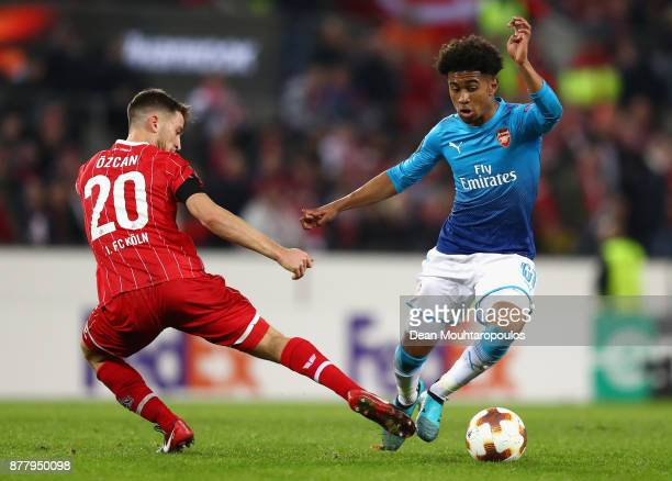 Salih Oezcan of FC Koeln and Reiss Nelson of Arsenal battle for possession during the UEFA Europa League group H match between 1 FC Koeln and Arsenal...