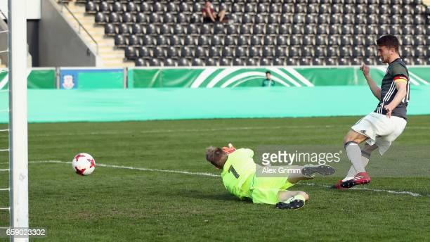 Salih Oezcan of Germany scores his team's second goal past goalkeeper Martin Vantruba of Slovakia during the UEFA Elite Round match between Germany...