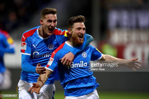 Salih Oezcan of Kiel celebrate with team mate Phil Yannik Neumann after he scores the opening goal during the Second Bundesliga match between...