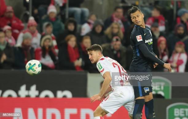 Salih Oezcan of Koeln and Davie Selke of Hertha BSC Berlin battle for the ball during the Bundesliga match between 1 FC Koeln and Hertha BSC at...