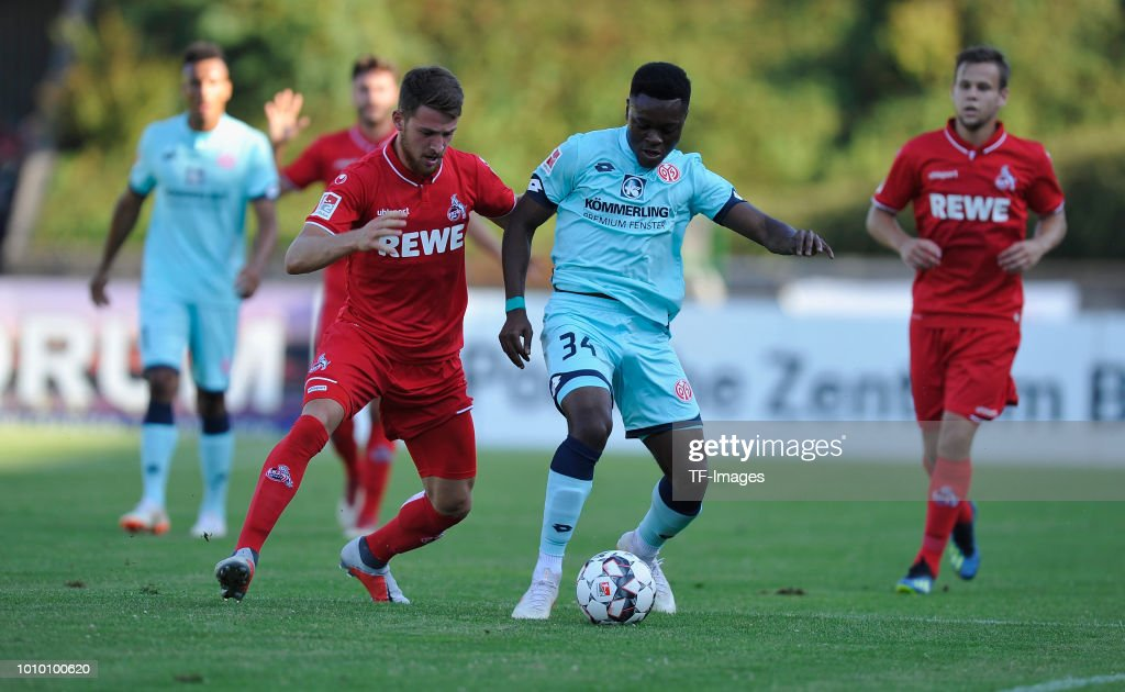 Salih Oezcan of Koeln and Ridle Baku of Mainz battle for the ball during the pre-season friendly match between 1. FC Koeln and 1. FSV Mainz 05 at Sportpark Nord on July 27, 2018 in Bonn, Germany.